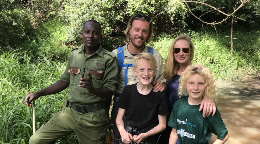 Belgian family take group photo while removing snares in Kenya.